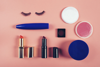 Overhead view of make-up equipment on colored background