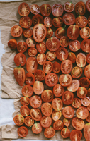 High angle view of tomato slices on table