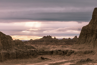 Scenic view of landscape against cloudy sky at Badlands National Park during sunset 11100091238| 写真素材・ストックフォト・画像・イラスト素材|アマナイメージズ