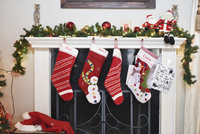 Christmas stockings hanging by fireplace at home