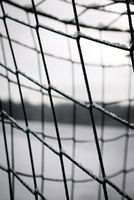 Close-up of snow on soccer net