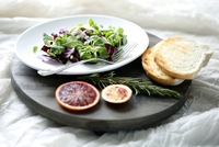 High angle view of salad with blood orange and rosemary by bread on cutting board 11100092036| 写真素材・ストックフォト・画像・イラスト素材|アマナイメージズ