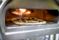 Close-up of pizza being cooked in oven 11100092155| 写真素材・ストックフォト・画像・イラスト素材|アマナイメージズ