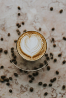 Overhead view of cappuccino with roasted coffee beans on table at cafe 11100106176| 写真素材・ストックフォト・画像・イラスト素材|アマナイメージズ
