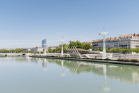Rhone River by buildings against blue sky in city during sunny day 11100112259| 写真素材・ストックフォト・画像・イラスト素材|アマナイメージズ