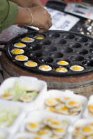 Cooking quail eggs, Chatuchak weekend market, Bangkok, Thailand, Southeast Asia