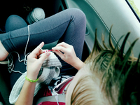 High Angle View Of Woman Crocheting Wool In Car 11115004810| 写真素材・ストックフォト・画像・イラスト素材|アマナイメージズ