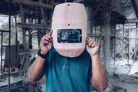 Welder Holding Welding Mask In Front Of Face At Construction Site 11115006978| 写真素材・ストックフォト・画像・イラスト素材|アマナイメージズ