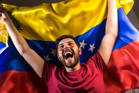 Excited Man Looking Away While Holding Venezuelan Flag 11115014114| 写真素材・ストックフォト・画像・イラスト素材|アマナイメージズ