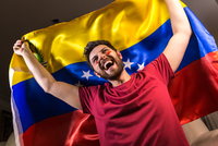 Excited Man Looking Away While Holding Venezuelan Flag 11115014115| 写真素材・ストックフォト・画像・イラスト素材|アマナイメージズ