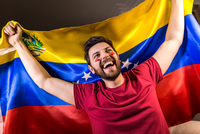 Excited Man Looking Away While Holding Venezuelan Flag 11115014116| 写真素材・ストックフォト・画像・イラスト素材|アマナイメージズ