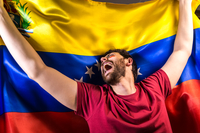 Excited Man Looking Away While Holding Venezuelan Flag 11115014117| 写真素材・ストックフォト・画像・イラスト素材|アマナイメージズ