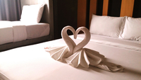 Swan Shape Towel On Bed