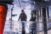 Reflection Of Person In Puddle Walking On Footpath 11115050681| 写真素材・ストックフォト・画像・イラスト素材|アマナイメージズ