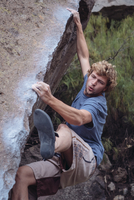 High Angle View Of Young Man Bouldering