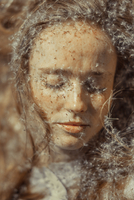 Close-up Of Young Woman With Dandelion Seeds