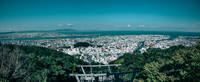 Panoramic View Of Cityscape Against Blue Sky 11115069967| 写真素材・ストックフォト・画像・イラスト素材|アマナイメージズ