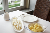 White Asparagus And Boiled Potatoes On Table At Home