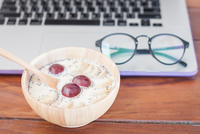 High Angle View Of Milk With Plum And Banana In Wooden Bowl Against Laptop 11115078660| 写真素材・ストックフォト・画像・イラスト素材|アマナイメージズ