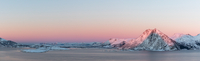 Panoramic Of Snowcapped Mountains At Sunset