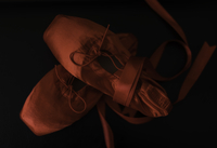 Close-up Of Ballet Shoes Against Black Background