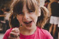 Close-up Of Girl Eating Chocolate Ice Cream Cone