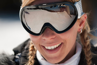 Close-up Portrait Of Smiling Mid Adult Woman Wearing Ski Goggles
