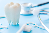 Close-up Of Dental Equipment Over Blue Background