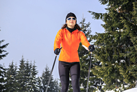 Woman Skiing Against Clear Sky
