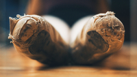 Close-up Of Old Ballet Shoes On Table