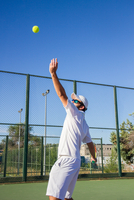 Man Playing Tennis On Court Against Blue Sky