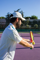 Man Playing Tennis On Court