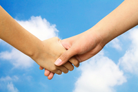 Cropped Friends Handshaking Against Cloudy Sky