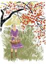 木の実を摘む女性