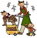 落ち葉を集める親子