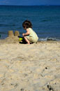 Girl playing on the beach making sandcastles