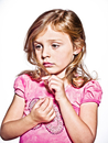 Portrait of Girl Wearing Pink Shirt and Looking to the Side, on White Background