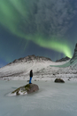 Norway, Province Troms, View of Aurora Borealis and a man