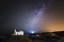 Spain, Galicia, Valdovino, Little chapel Virxe do Porto in the galician coast in a night shot with stars and milky way