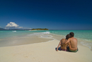 Happy couple on their honeymoon at the beautiful beach of Nosy Iranja near Nosy Be, Madagascar, Indian Ocean, Africa
