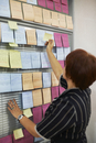 Woman at pin board in office