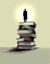 Graduate standing on pile of books