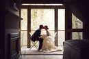 bride and groom share a quiet moment and kiss