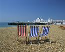 Empty deck chairs on the beach and the Southsea Pier, Southsea, Hampshire, England, United Kingdom, Europe