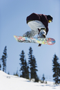 A snowboarder jumping at Telus Half Pipe competition 2009, Whistler mountain, 2010 Winter Olympics venue, British Columbia, Cana
