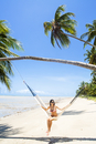South America, Brazil, Alagoas, Praia do Patacho, an attractive young woman sitting in a hammock on the beach MR