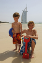 Children playing in front of the Burj al Arab Hotel, Dubai, United Arab Emirates MR