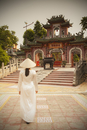 Woman wearing Ao Dai dress at Phouc Kien Assembly Hall, Hoi An (UNESCO World Heritage Site), Quang Ham, Vietnam (MR)