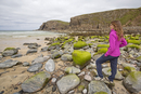 Woman staring at Dailbeag beach, Isle of Lewis, western scotland,United Kingdom
