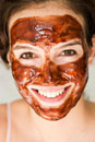 Woman in chocolate mask eating chocolate